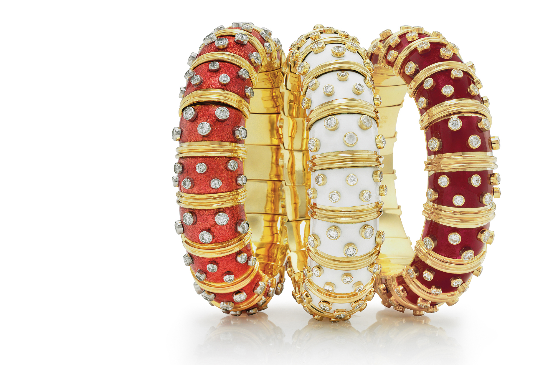 Three  exquisite gold enamel diamond  bracelets standing together