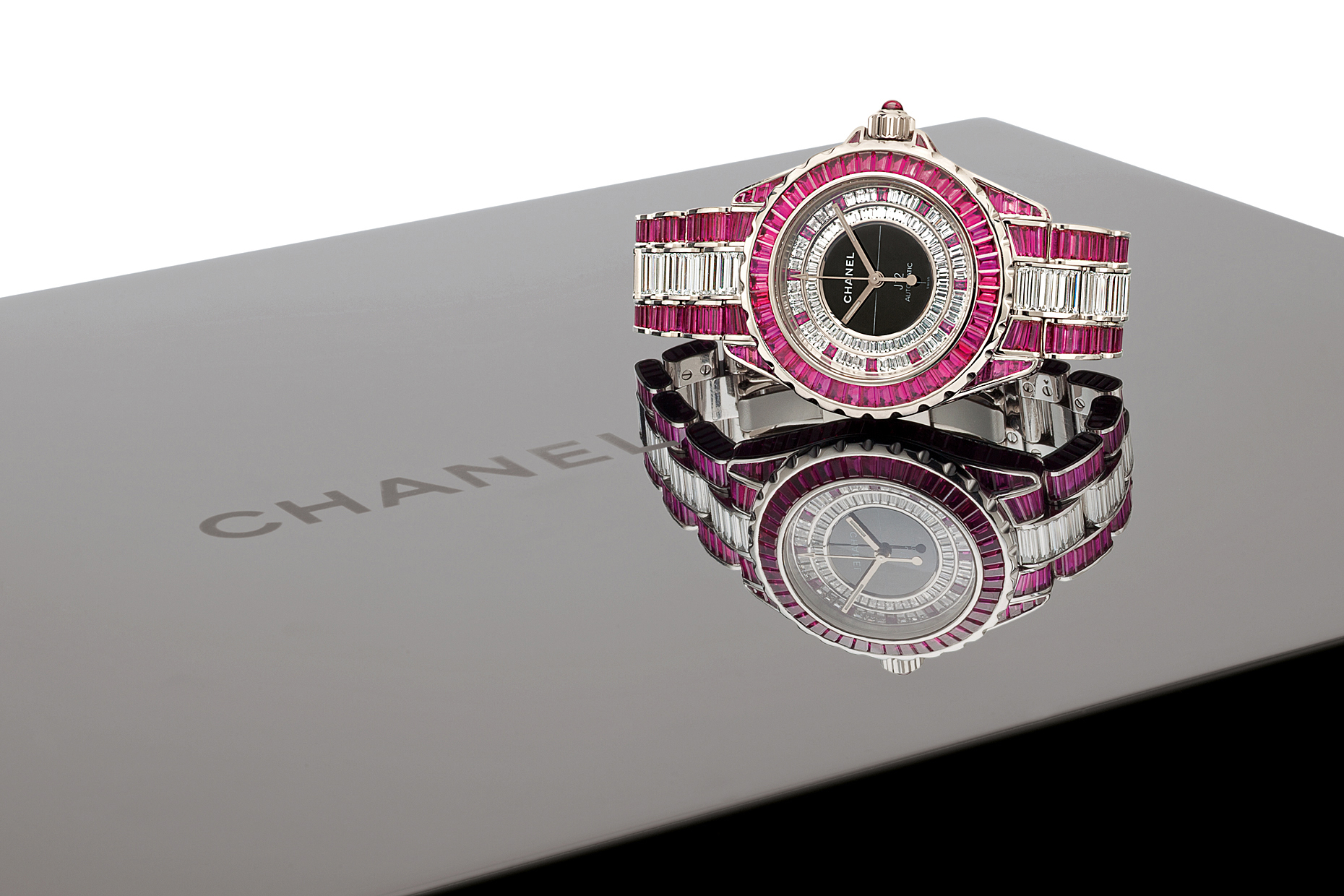 A diamond and pink Chanel watch