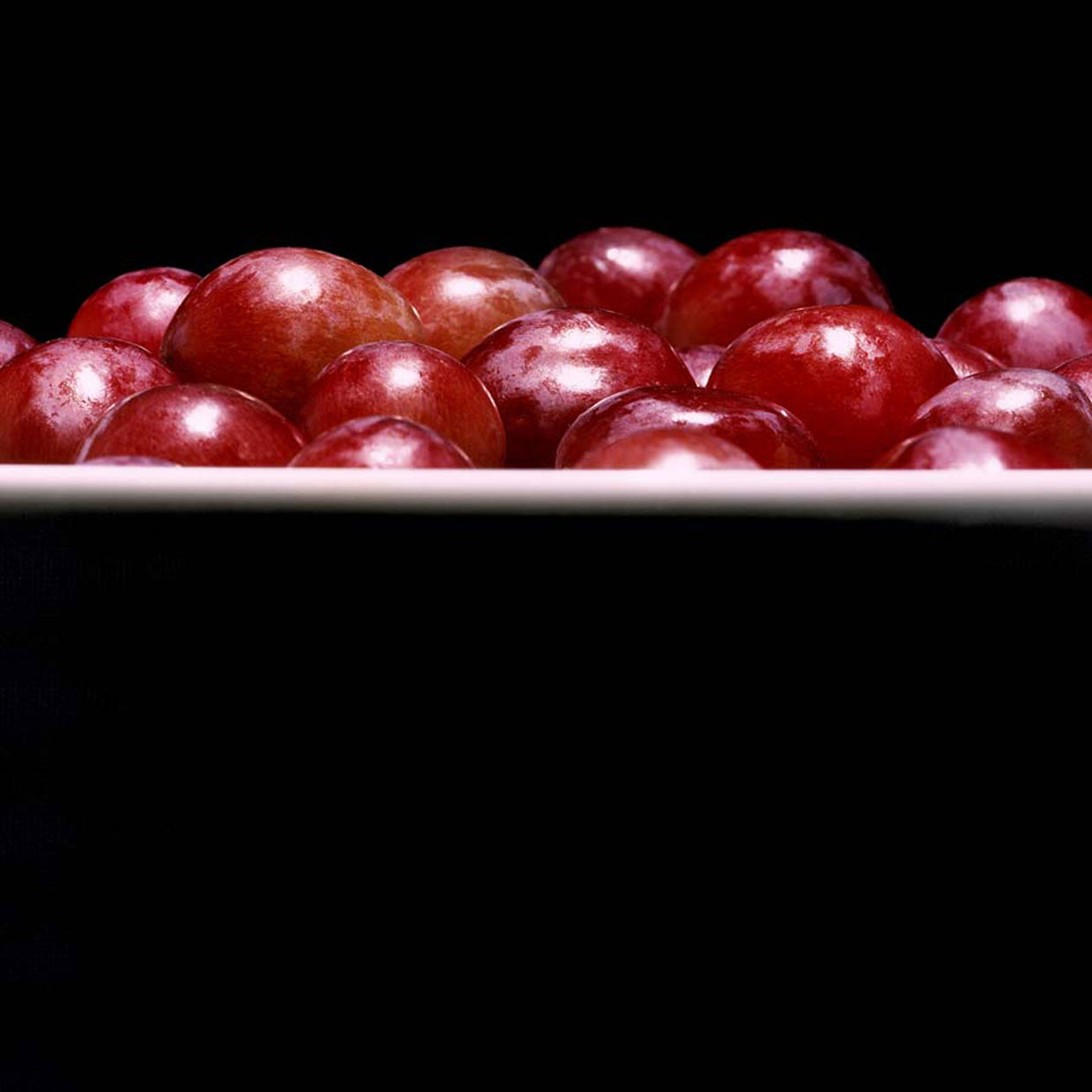 A profile of red grapes in a bowl