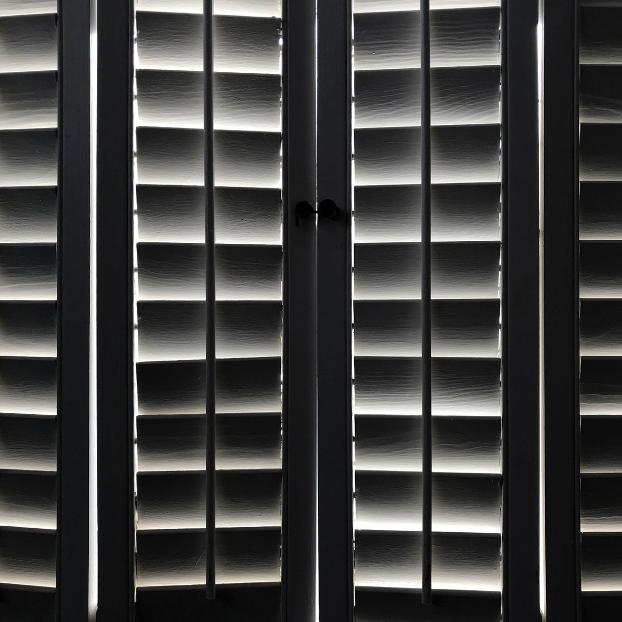 Wooden shutters with glowing light