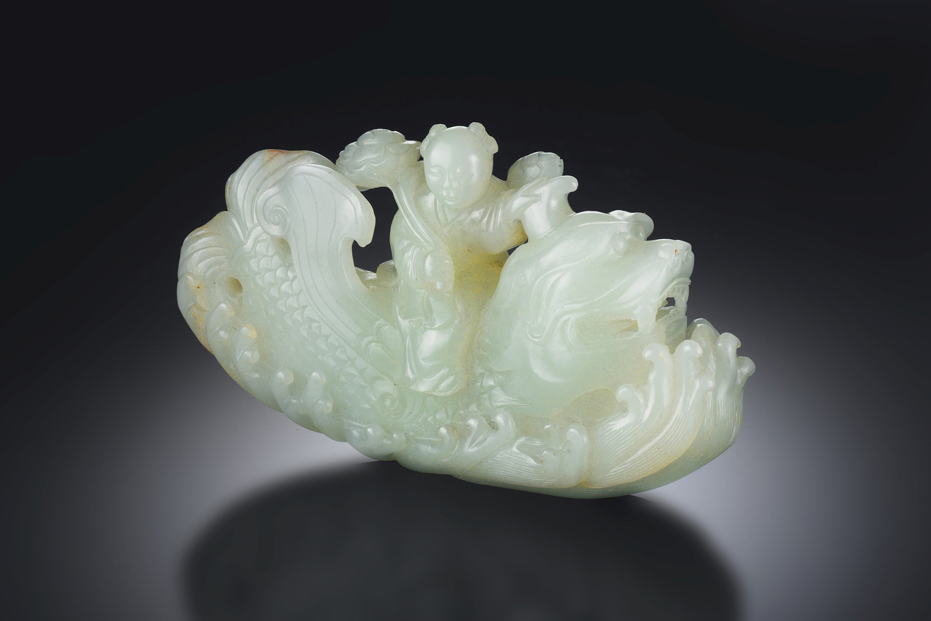 An ancient Chinese jade carving of a man riding a dragon
