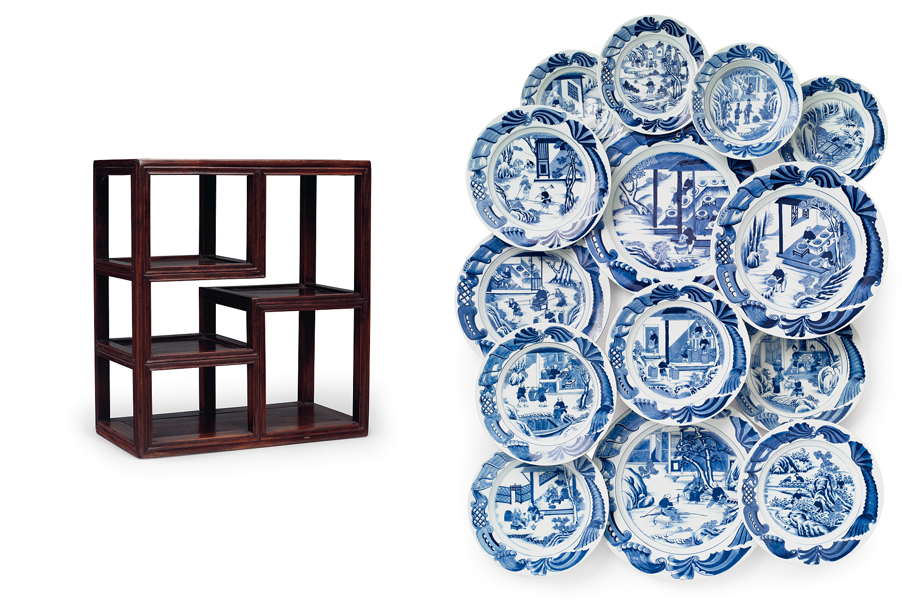 A wooden Chinese furniture piece and a collection of blue and white porcelain plates