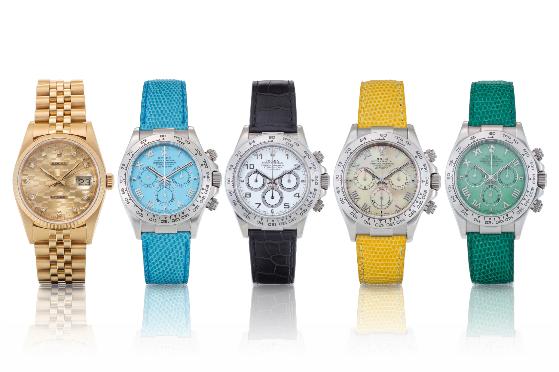 Five colorful Rolex watches standing